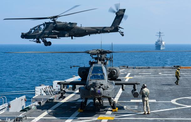AH-64E attack helicopters of the Australian Defense Force taking off and landing on the HMAS Adelaide (Image Source:The Australian Defense Force).
